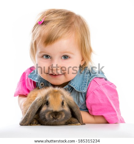 cute little baby and brown easter bunny on white background - stock photo