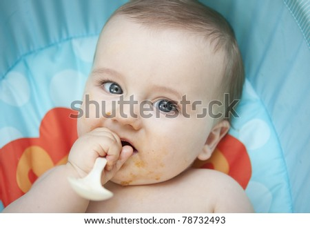 cute little baby boy eating