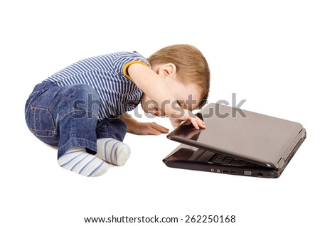 Cute little baby boy look into laptop isolated on white background - stock photo