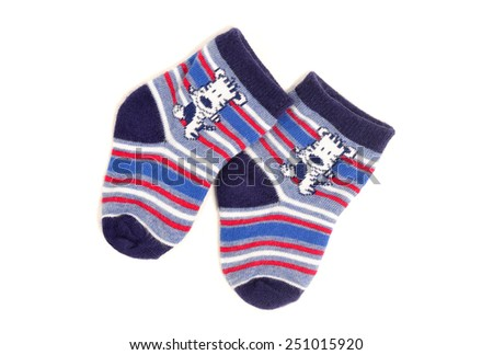Cute little baby boy socks isolated on white. Small blue socks with stripes and animals. - stock photo