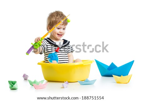 Cute little baby fishing - stock photo