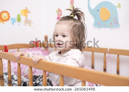 Cute little baby girl in crib