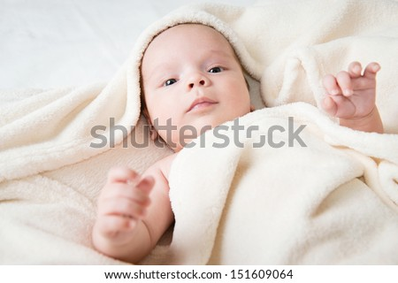 cute little baby hidden in blanket  - stock photo
