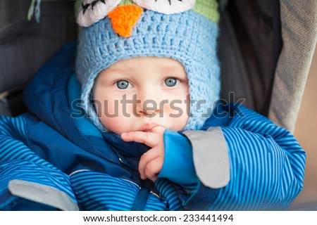 Cute little baby in a stroller outdoor - stock photo