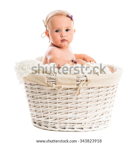 cute little baby in a wicker isolated on white background - stock photo