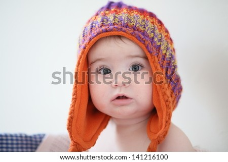 Cute little baby in big hat - stock photo