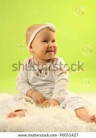 cute little baby on green background - stock photo