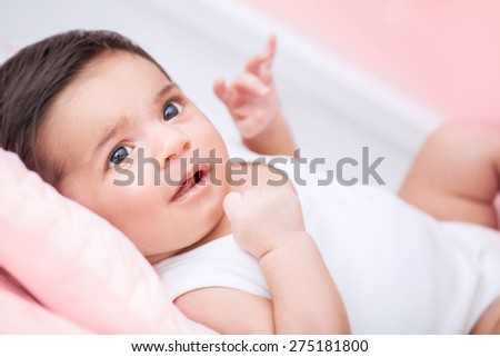 Cute little baby portrait, sweet adorable newborn child lying down on bed at home, healthy lifestyle, happy childhood concept - stock photo