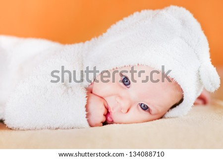 Cute little baby sucking his fingers - stock photo