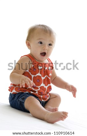 Cute little baby with her mouth open in surprise - stock photo