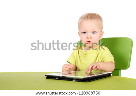 cute little baby with the tablet PC - stock photo