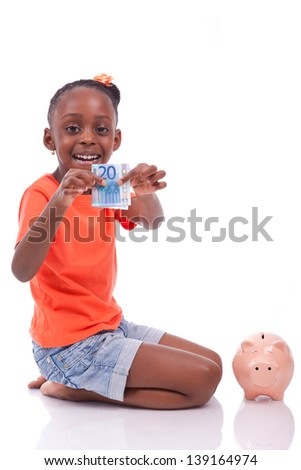 Cute little black girl inserting an euro bill inside a piggy bank, isolated on white background - African children