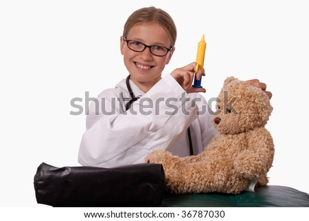 Cute little blond girl dressed up like a doctor holding a pretend needle and a brown teddy bear smiling - stock photo