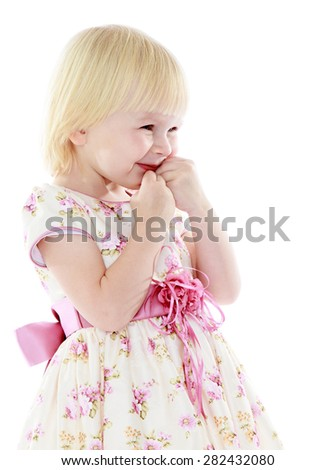 Cute little blonde girl in a beautiful elegant dress- isolated on white background - stock photo