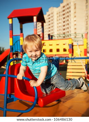 Cute little boy at playground area - stock photo