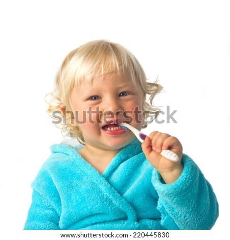 Cute little boy brushing teeth - stock photo