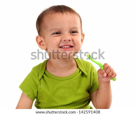 Cute little boy brushing teeth, isolated on white - stock photo