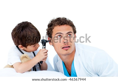 Cute little boy checking doctor's ears against a white background - stock photo