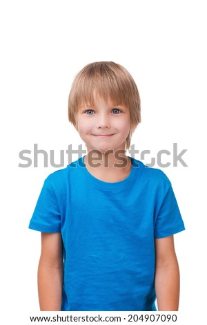 Cute little boy. Cheerful little boy looking at camera and smiling while standing isolated on white - stock photo