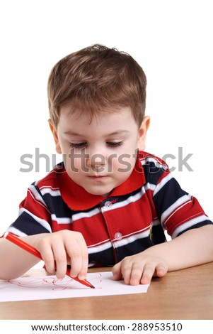 cute little boy drawing isolated on white - stock photo