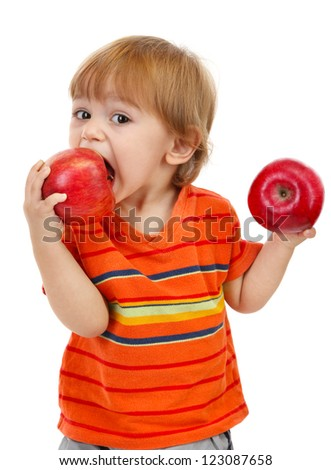 cute little boy eating apples, isolated on white - stock photo