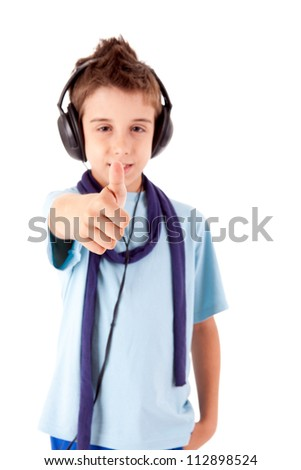 Cute little boy enjoying music using headphones and showing thumbs up - stock photo