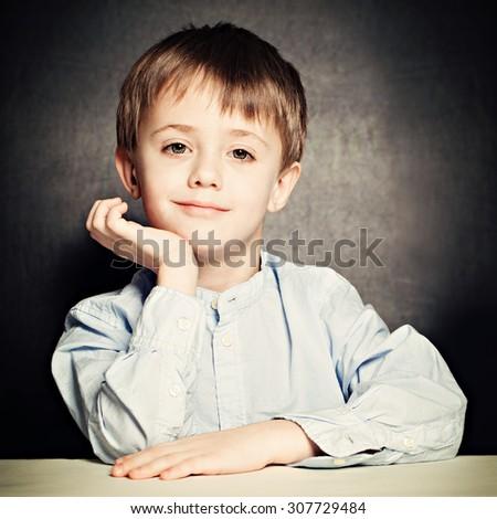 Cute Little Boy. Happy Child on Blackboard Background - stock photo