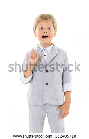 Cute little boy has idea, portrait over white background