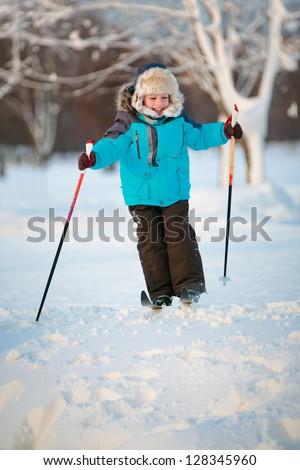 Cute little boy having fun during skiing on cross - stock photo