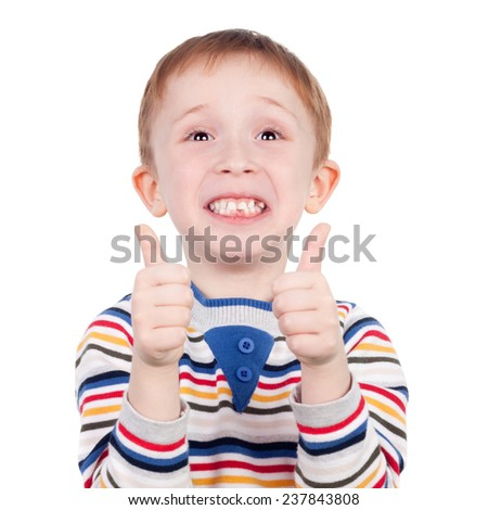 cute little boy holding the thumbs up - stock photo