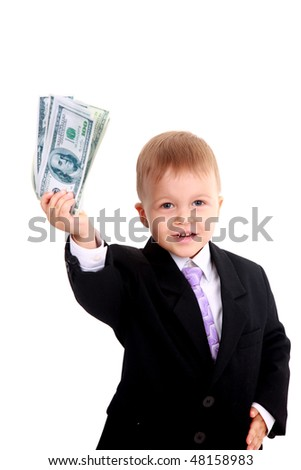 Cute little boy holds a fan of banknotes - stock photo