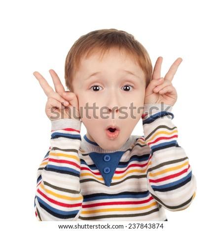 cute little boy imitating the sheep's horns - stock photo