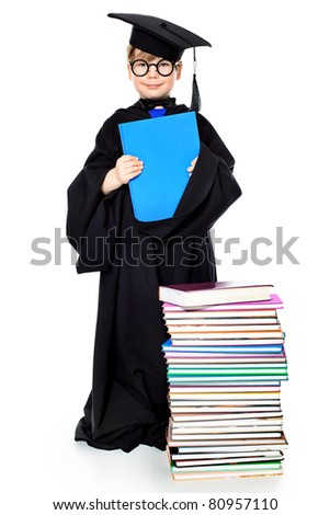 Cute little boy in a graduation gown. Isolated over white. - stock photo