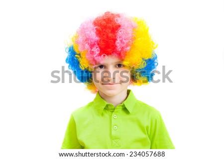 cute little boy in a multi-coloured clown wig - stock photo