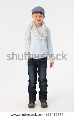 Cute little boy in casual clothes smiling, looking at camera.