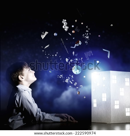Cute little boy in dark room dreaming about home and family - stock photo