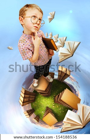 Cute little boy in glasses standing on abstract book planet