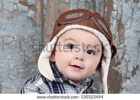 Cute little boy in pilots Helmet - stock photo