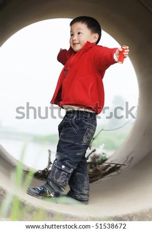 cute little boy in Sewer - stock photo