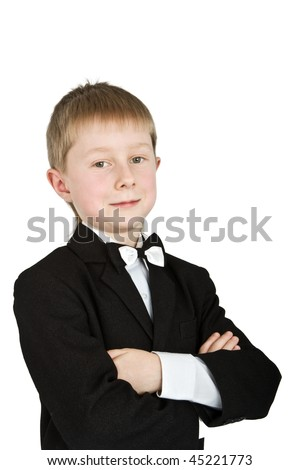 Cute little boy in suit and bow tie