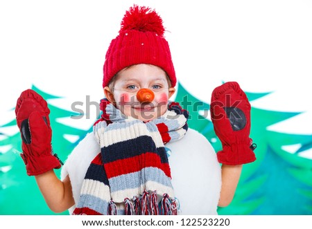 Cute little boy in suit snowman in red hat and mittens - stock photo