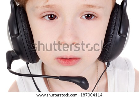 cute little boy in the headphones, closeup - stock photo