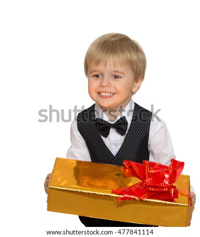 Cute little boy in white shirt, vest and tie ,holding a box with a gift - Isolated on white background