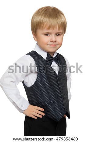 Cute little boy in white shirt, vest and tie , turned the camera sideways  - Isolated on white background