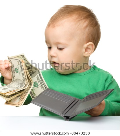 Cute little boy is counting money, isolated over white - stock photo