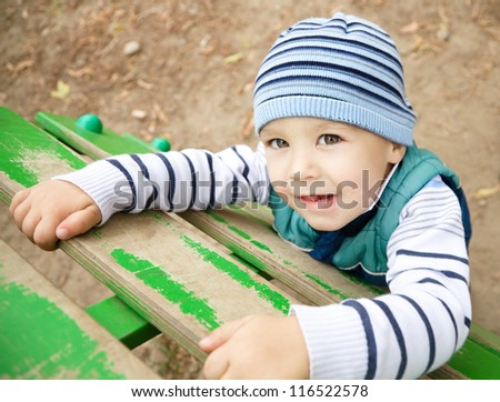 Cute little boy is playing on playground - stock photo
