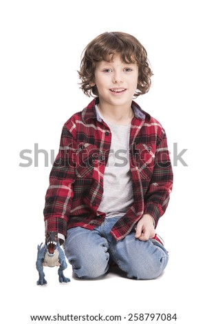 Cute little boy is playing with a toy. Isolated on white background. - stock photo
