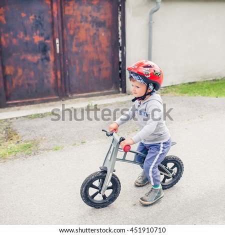 Cute Little Boy Is Riding His Bike on Street