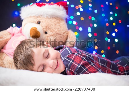 cute, little boy on  Christmas lights background