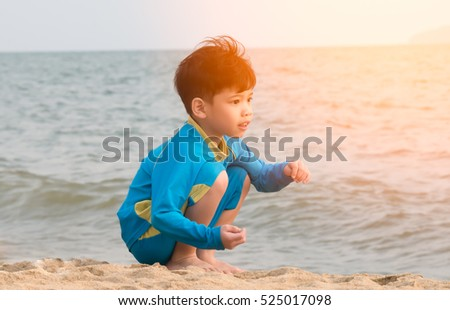 Cute little boy on the beach